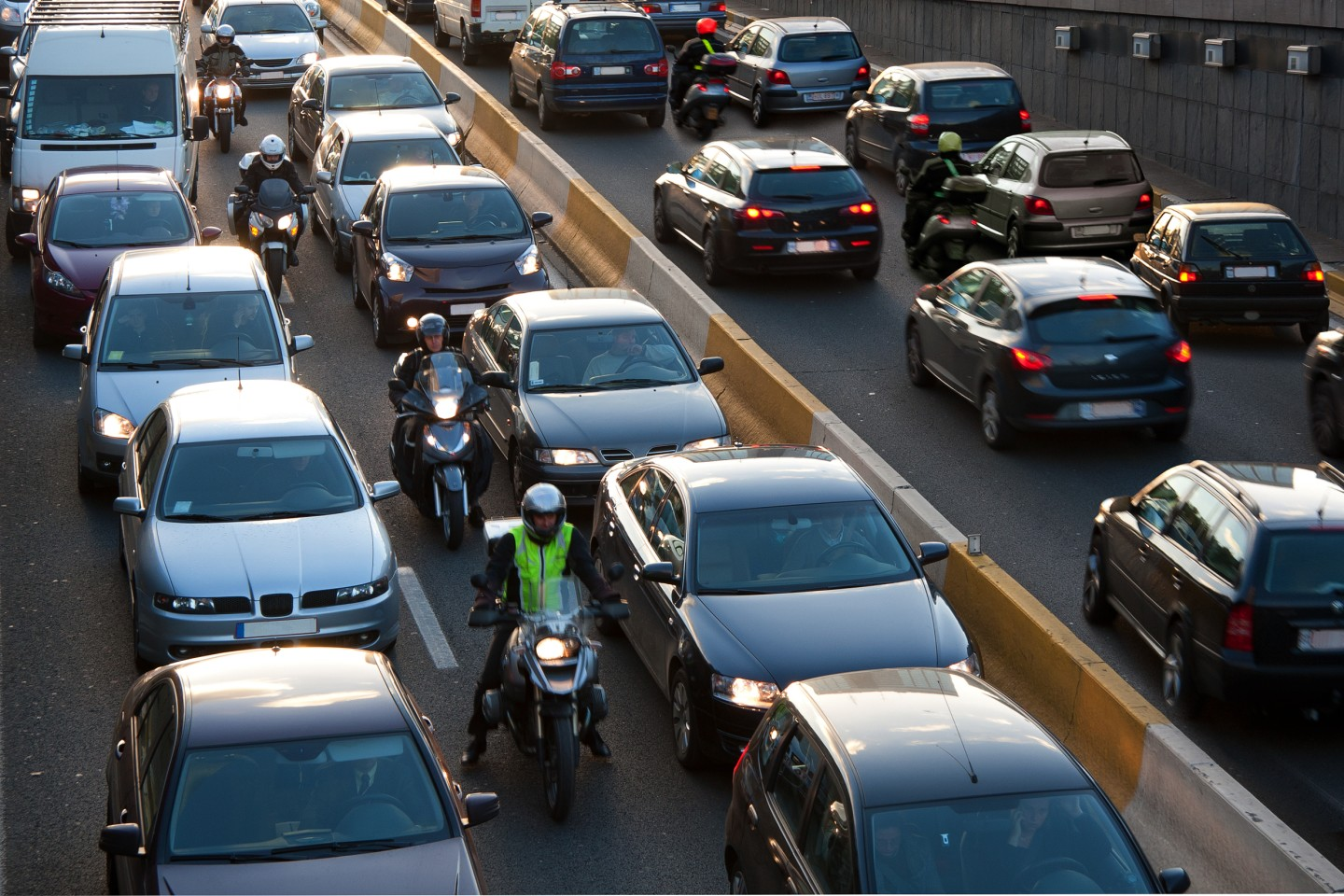 motorcyclists lane filtering in traffic