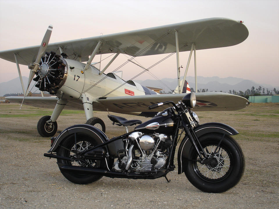 1941 Harley-Davidson FL Parked In Front Of A Plane