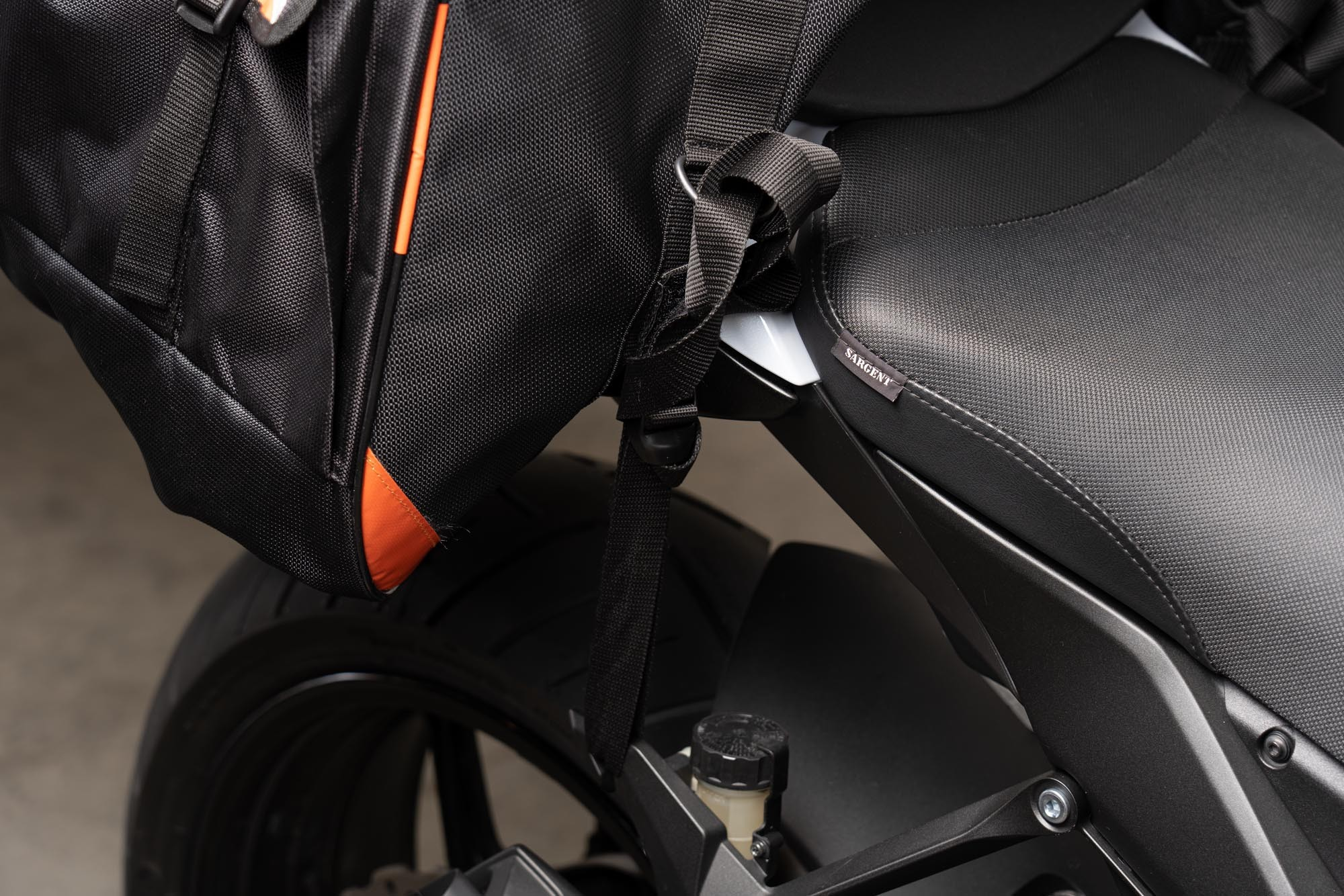 70086 Sentor bag attached to Ninja 1000 using footpeg luggage hooks