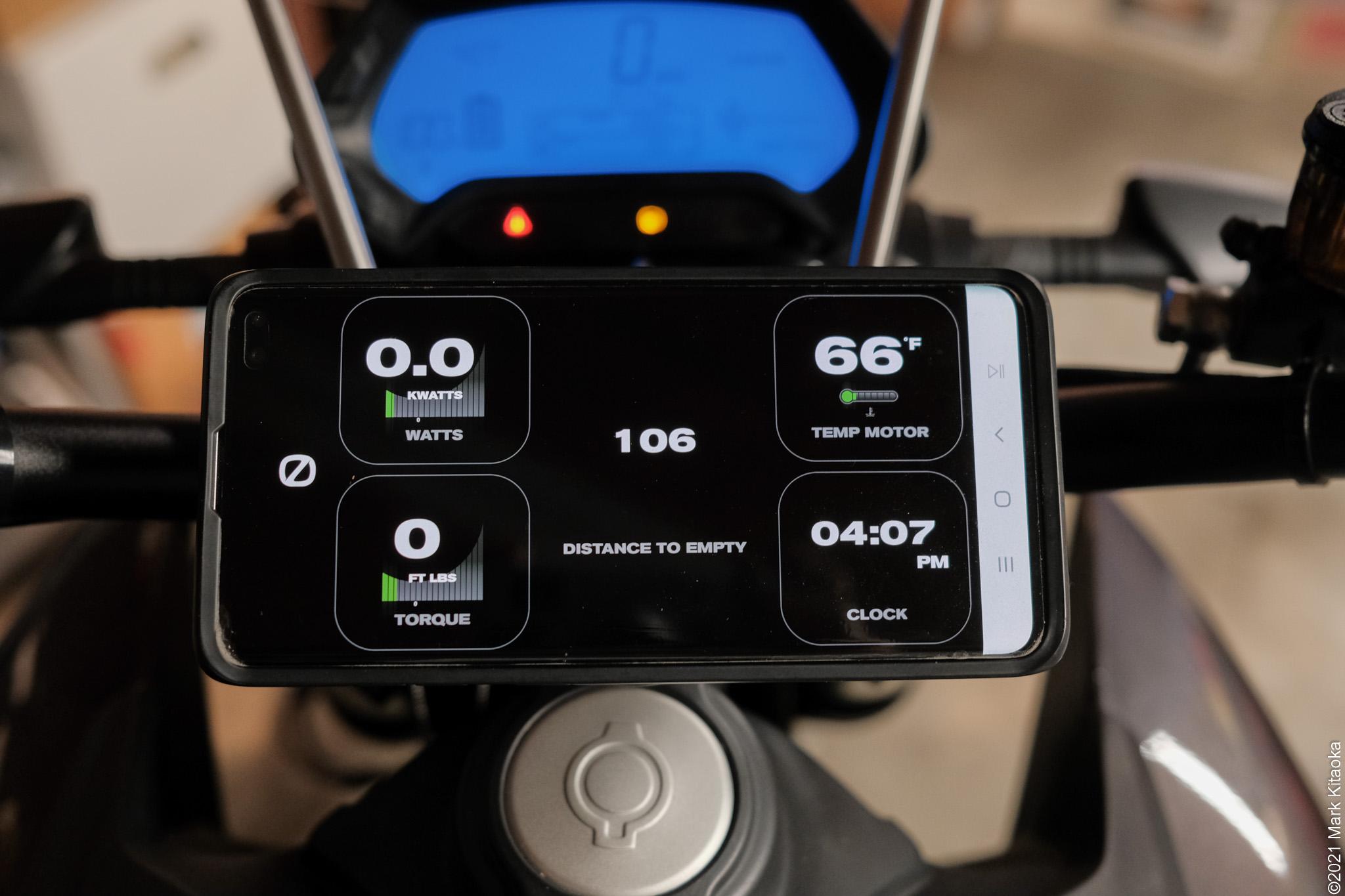 Smartphone app on handlebar mount showing various settings