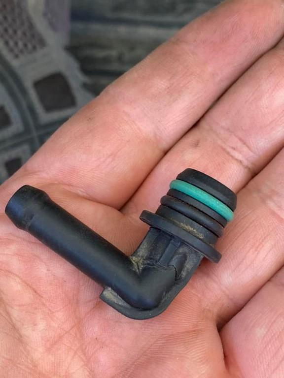A broken elbow fitting from a KTM 790 adventure fuel tank.