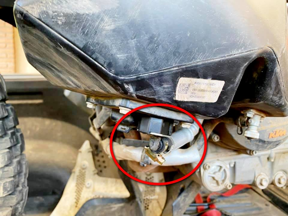 The fuel pump on the bottom of a KTM 790 adventure gas tank.