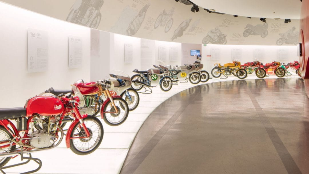A row of Ducati motorcycles at the Ducati Museum in Bologna, Italy