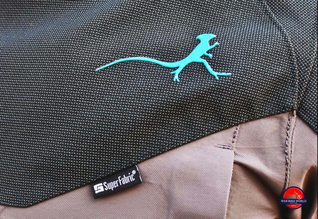 The Mosko Moto brand logo is a Basilisk lizard silhouette.