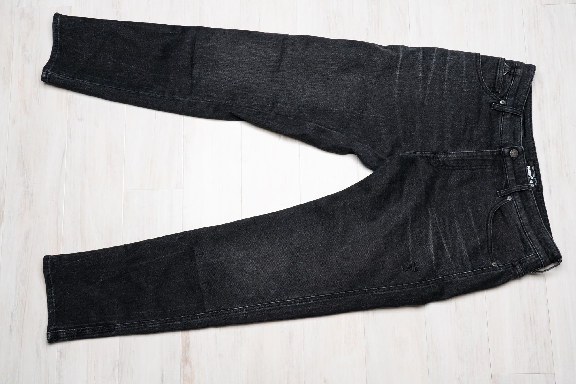 Pre-distressed black denim look