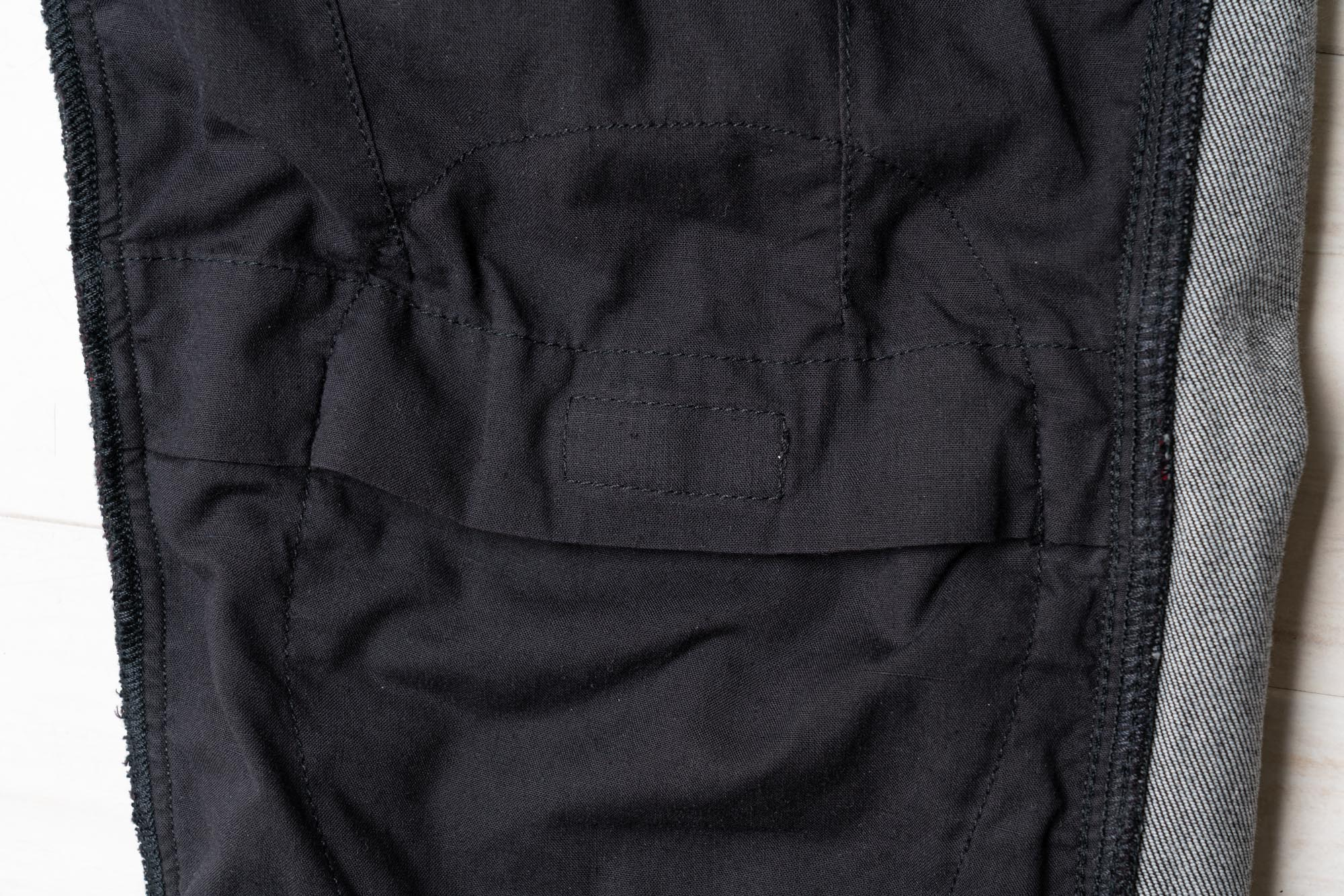 Hook and loop patch on the inside of Pando Moto jeans