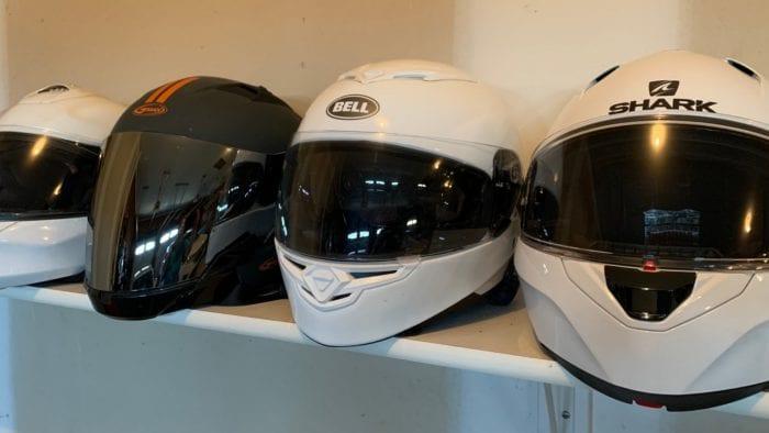 Motorcycle helmets on a shelf
