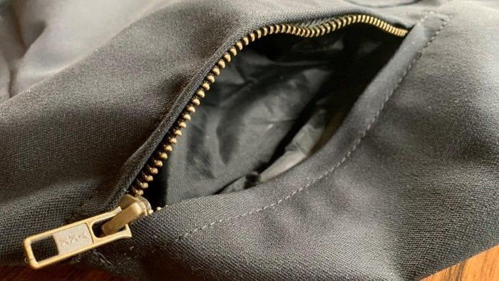 Water resistant front hand warmer pocket of Raven Rova Raven Pants
