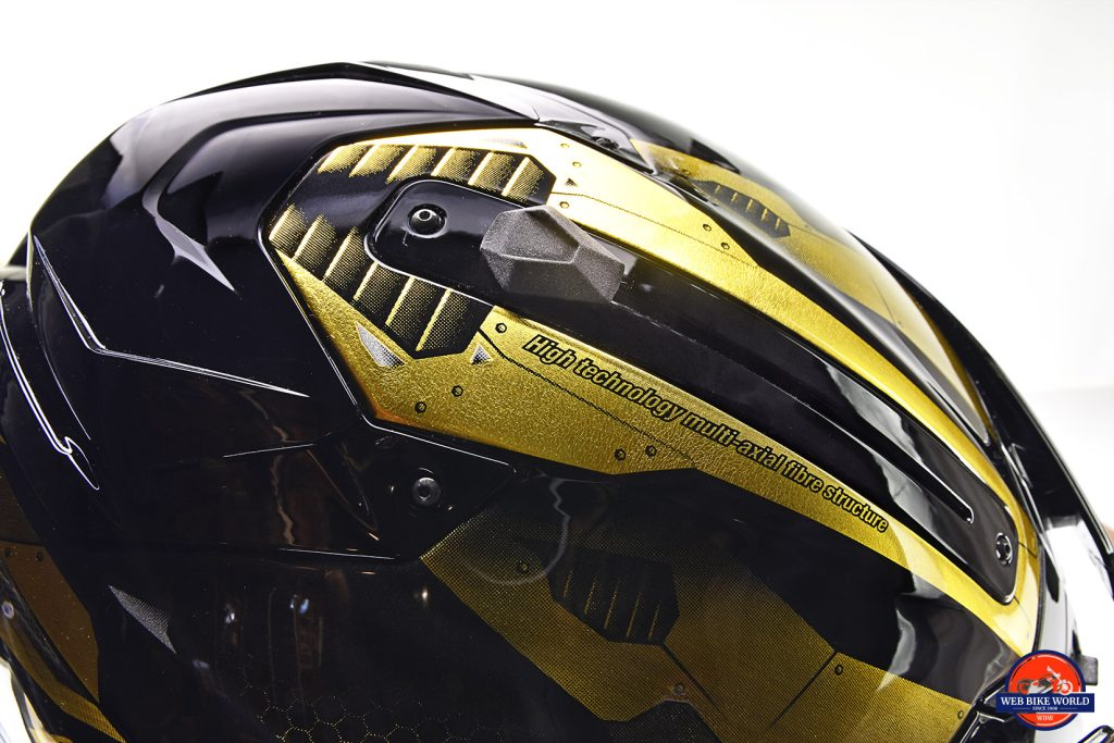The Shark Spartan GT Replikan has a sliding switch on top to lower/raise the integrated sun visor.