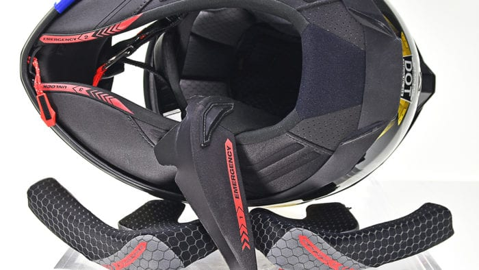 The Shark Spartan GT Replikan interior padding has an emergency removal system on it.