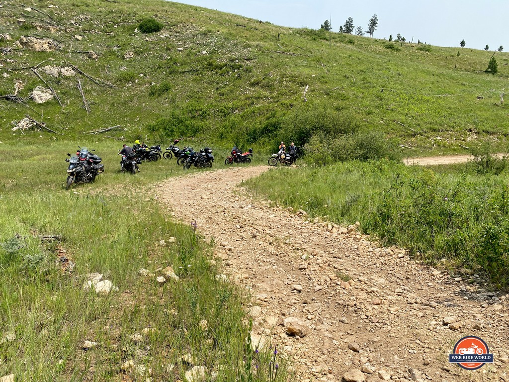 A bunch of other riders parked their motorcycles and helped move Brian's Africa Twin off the rocky trail.