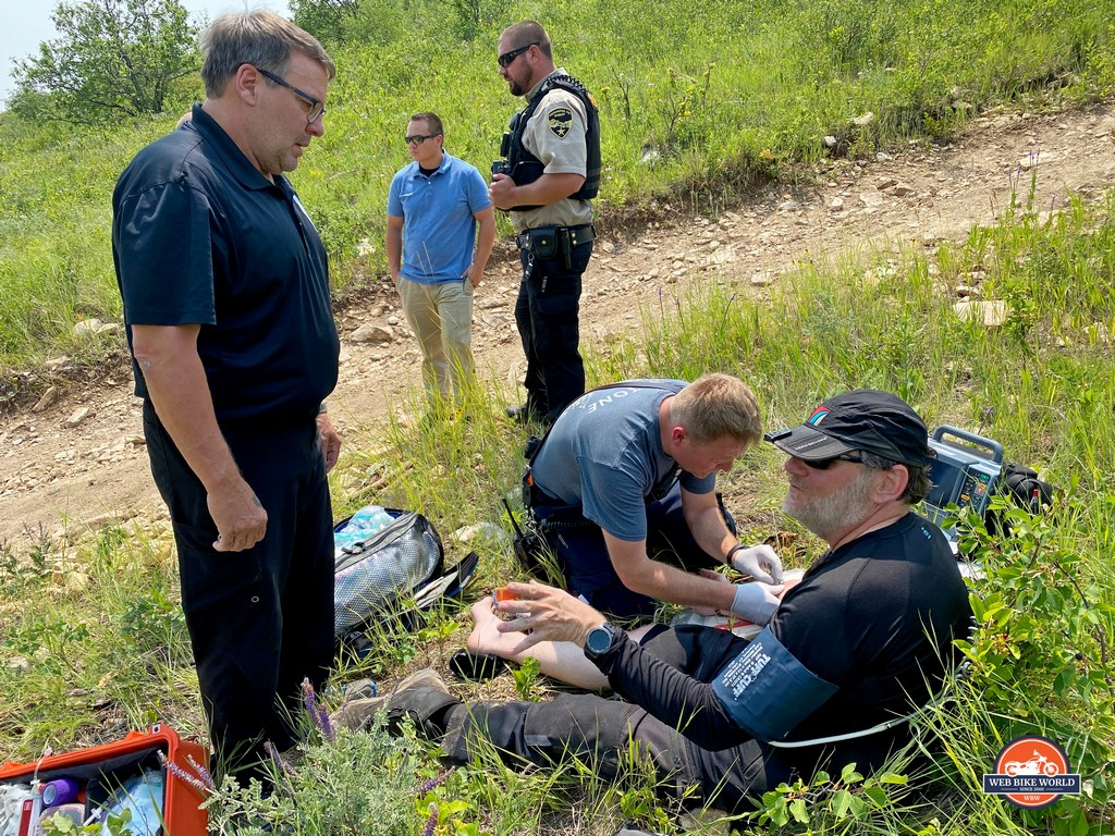 Brian receiving medical aid from paramedics out on the trails near Rapid City, SD.