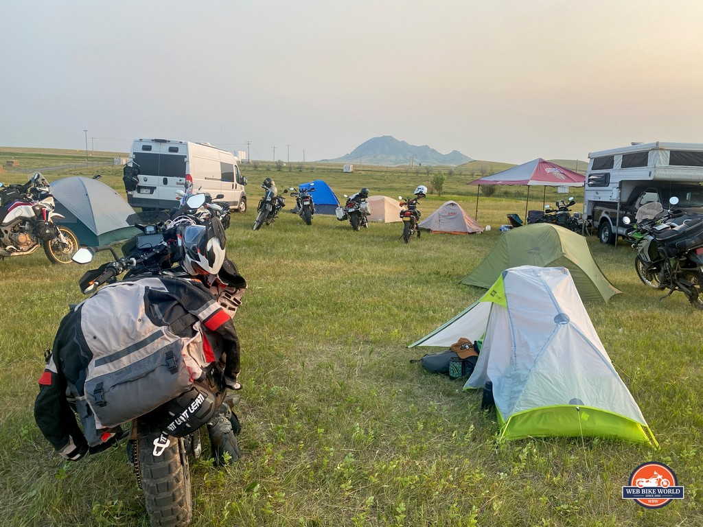 The campsite at Buffalo Chip full of campers and motorcycles.`