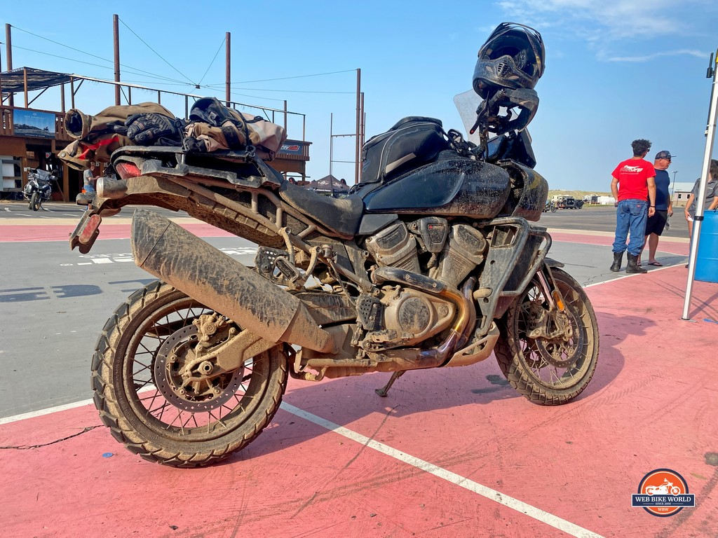A Harley Davidson Pan America covered in mud.