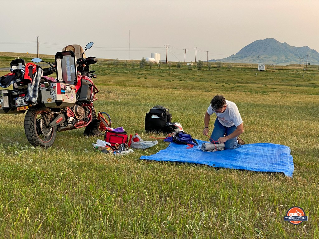 A rally participant packing up his camp before starting the journey home.