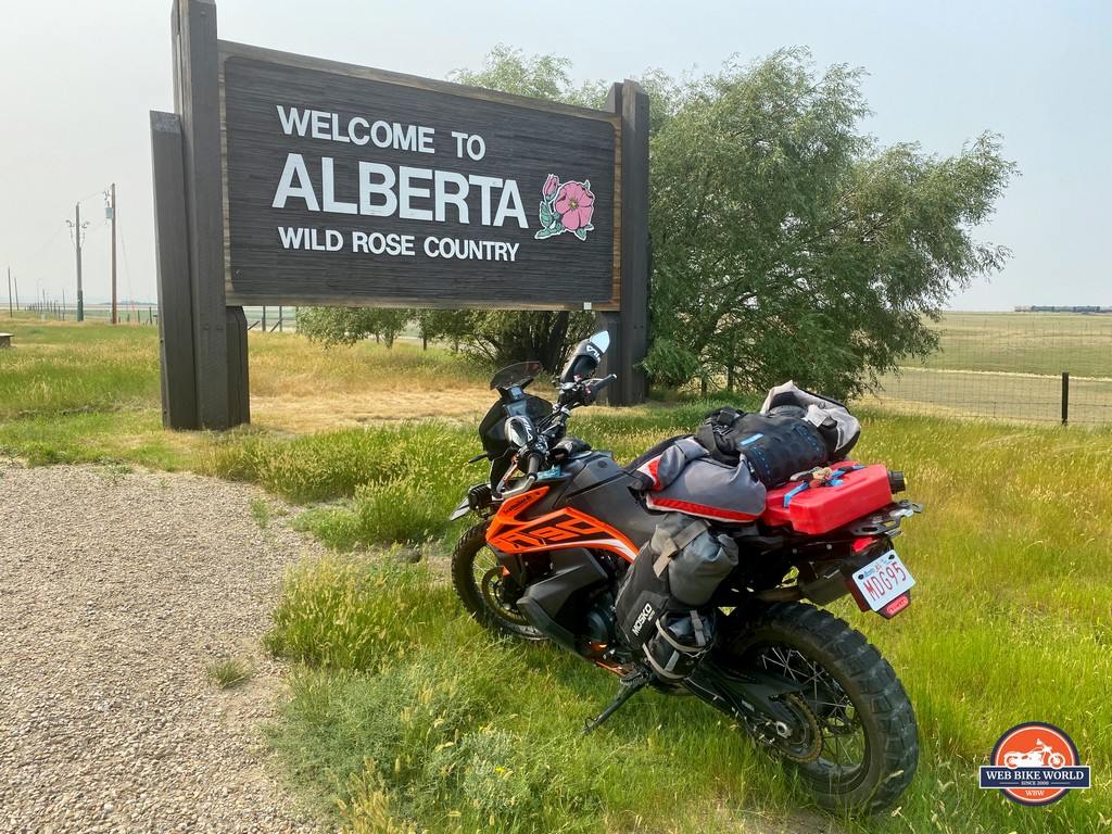 My KTM 790 Adventure sitting by the welcome sign to Alberta, Canada.