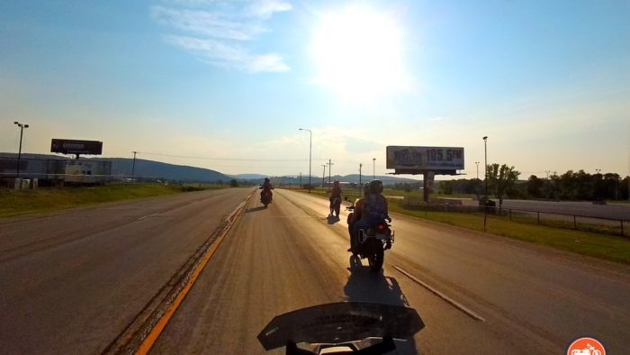 Riding motorcycles near Sturgis, SD at sunset.