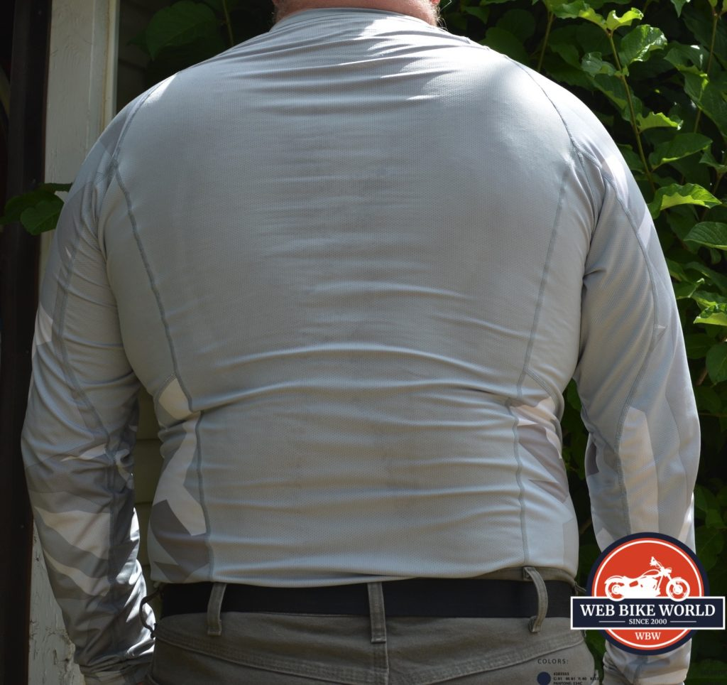 A view of the KLIM Aggressor -1.0 Cooling Shirt from the back.