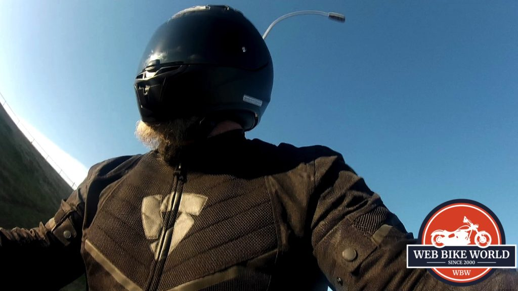 A view of the model wearing the KLIM Aggressor -1.0 Cooling Shirt under will motorcycle attire.