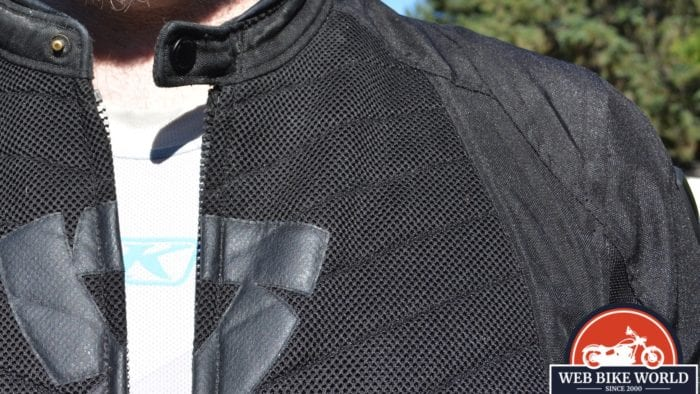 A view of the KLIM Aggressor -1.0 Cooling Shirt underneath the model's usual motorcycle attire.