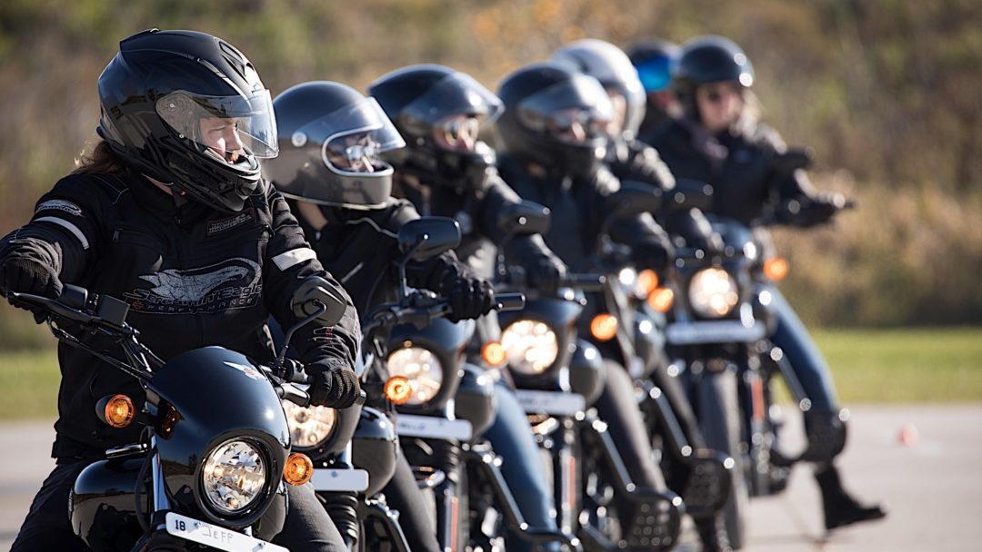 a view of new riders on their bikes for Harley Davidson