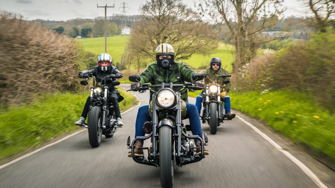 a trifecta of motorcycle riders enjoying their respective bikes
