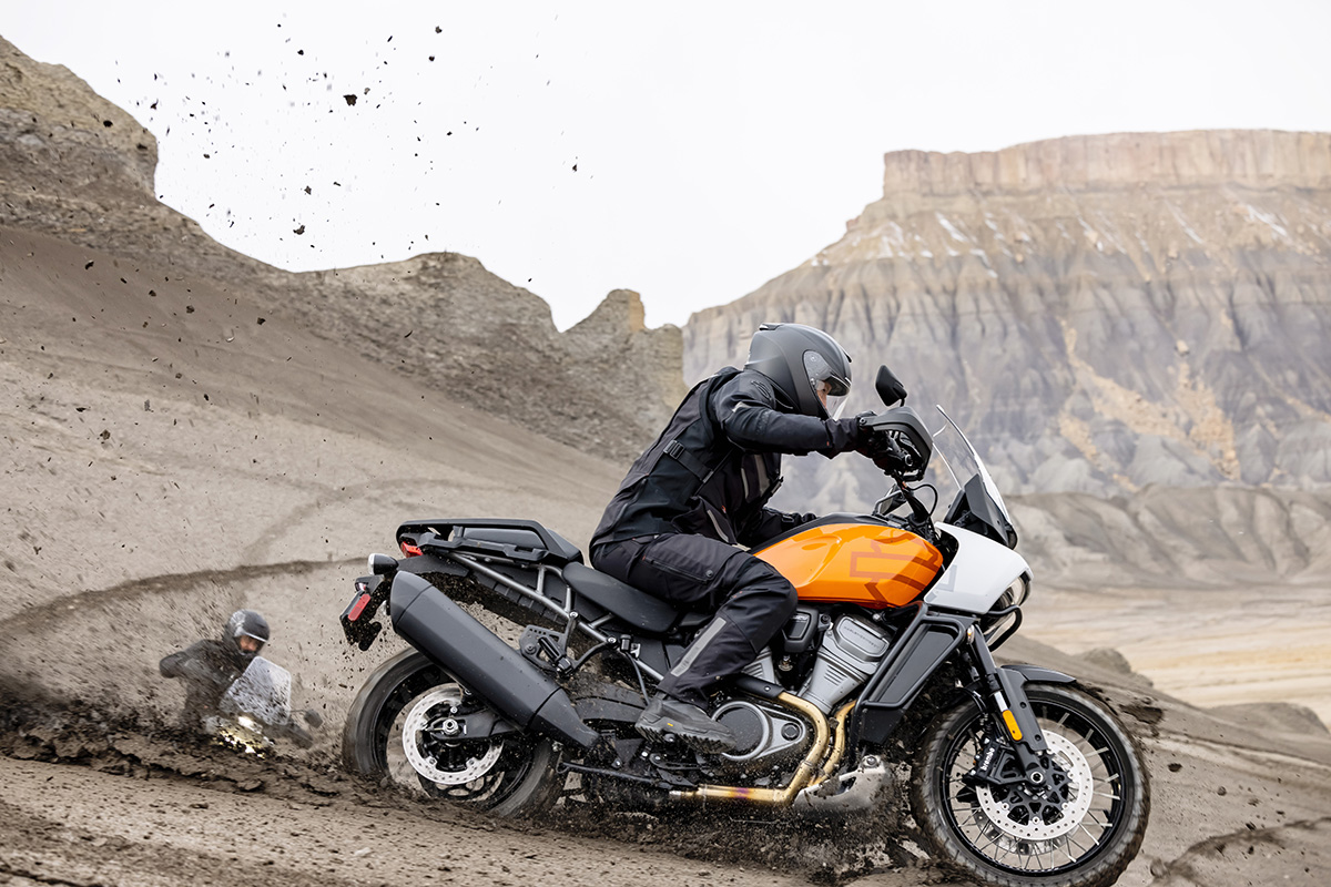 A side view of a rider tricking out on the all-new Harley Davidson Pan America