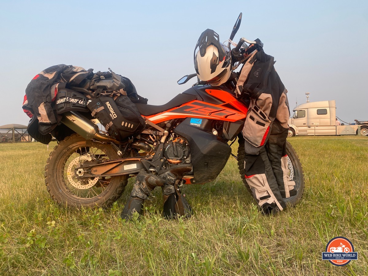 A KTM 790 Adventure with riding gear draped over it.
