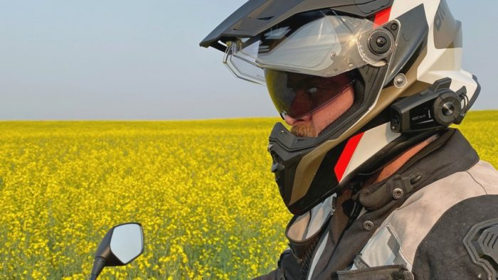 Me wearing the BMW GS Pure helmet in front of a canola field.