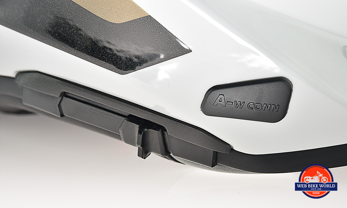 The sliding switch used to lower/raise the integrated sun visor on the BMW GS Pure helmet.