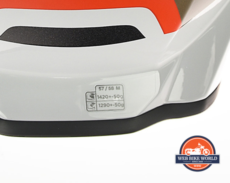 There's a sticker on the back of the BMW GS Pure helmet with the weight listed on it.
