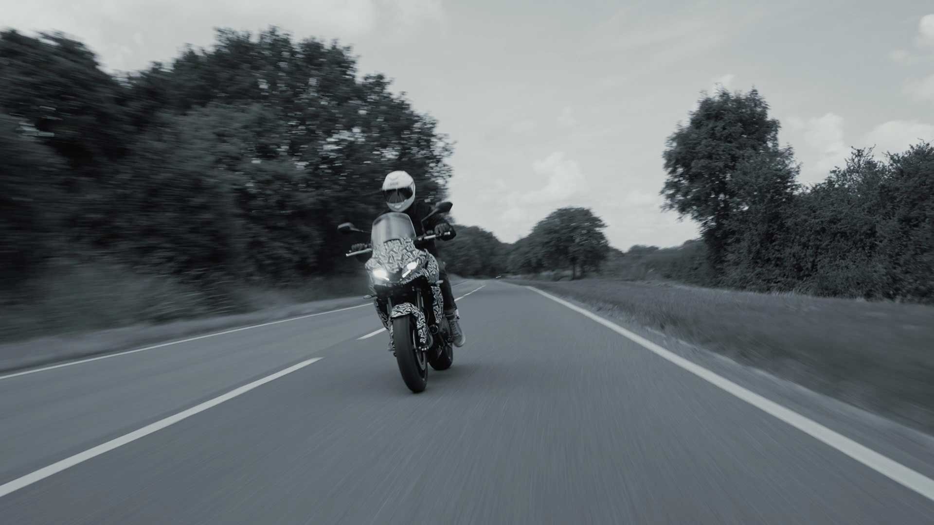 A blurry view of a rider enjoying the new Triumph Tiger prototype, features in a Triumph Tiger Tease release from the UK company.