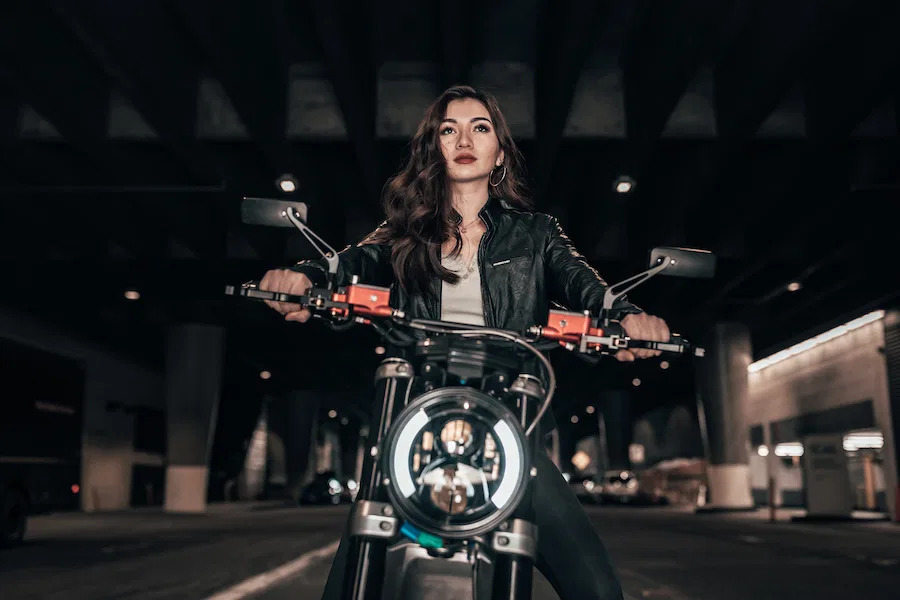 A front view of a model riding the all-new SONDORS Metacycle