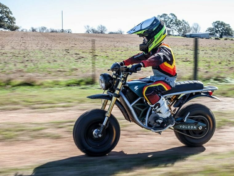 A view of a small child trying out the Runt - an all-terrain electric motorcycle made available to USA and Latina America from Volcon Powersports this summer 2021
