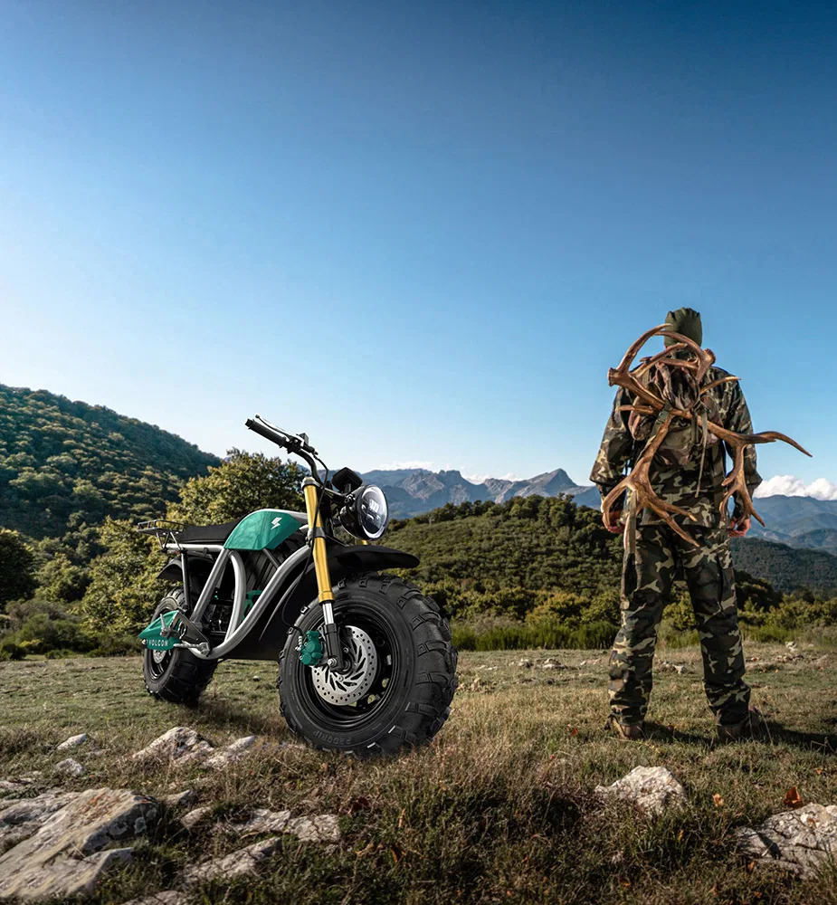 A view of a hunter and his Grunt, an all-terrain electric motorcycle available from Volcon Powersports