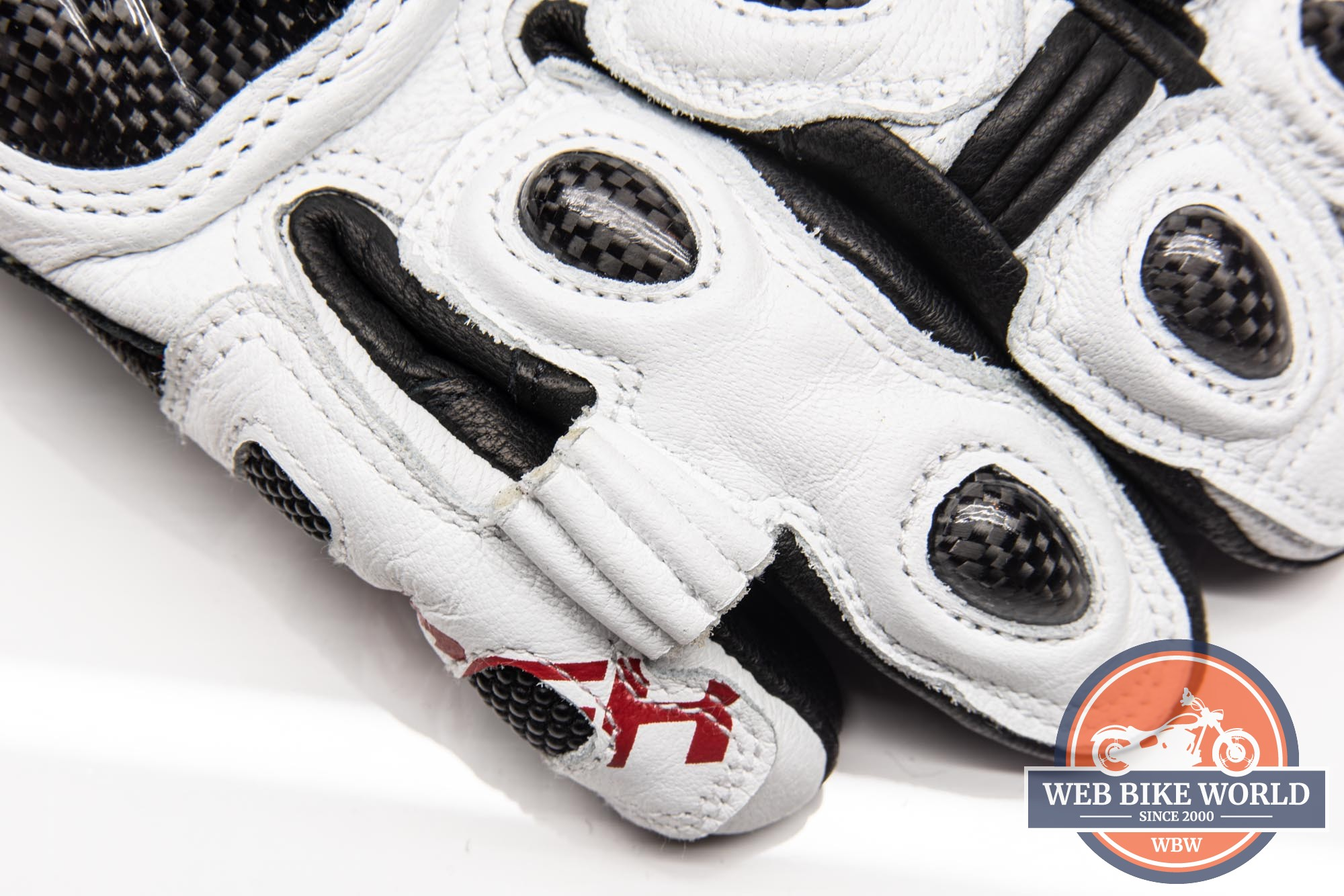 Closeup of ring and little finger bridge on Hi Per gloves