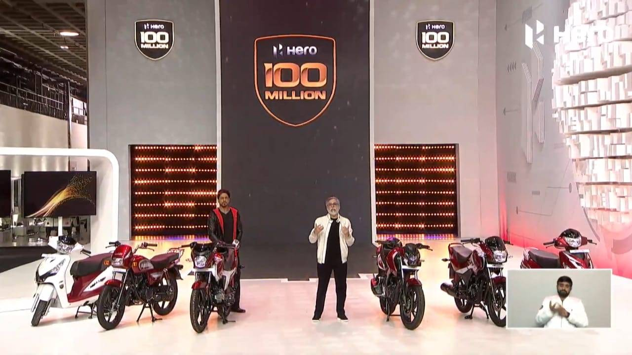 A view of two presenters showing off bikes fro Hero Motorcorp in India